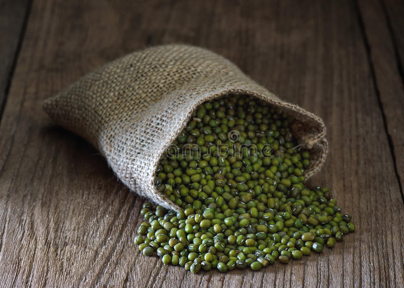 Green gram or mung bean. In sacks on table stock images