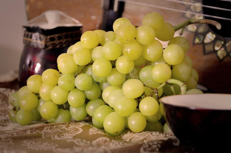 Green Grapes With a Guitar on the background. Beautiful Color and Focus perspective royalty free stock photos