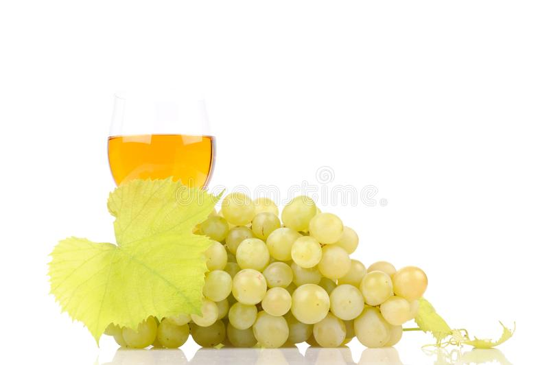 Green grapes with leaf and wine in the glass. Alcohol, background, bar, beverage, blank, cabernet, celebration, clean, clear, drink, elegance, food, full stock images
