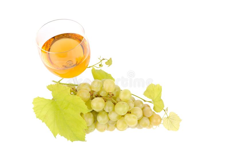 Green grapes with leaf and wine in the glass. Alcohol, background, bar, beverage, blank, cabernet, celebration, clean, clear, drink, elegance, food, full stock photo