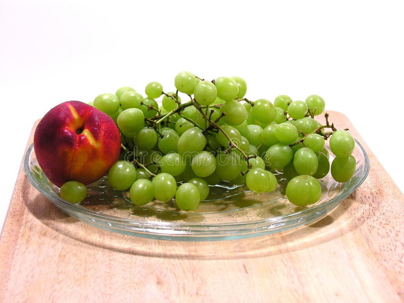 Green Grapes and Nectarine or Peach stock photography