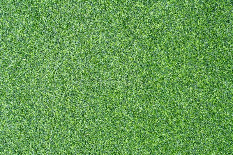 Green grass background. Artificial grass for background or wallpaper. stock photos
