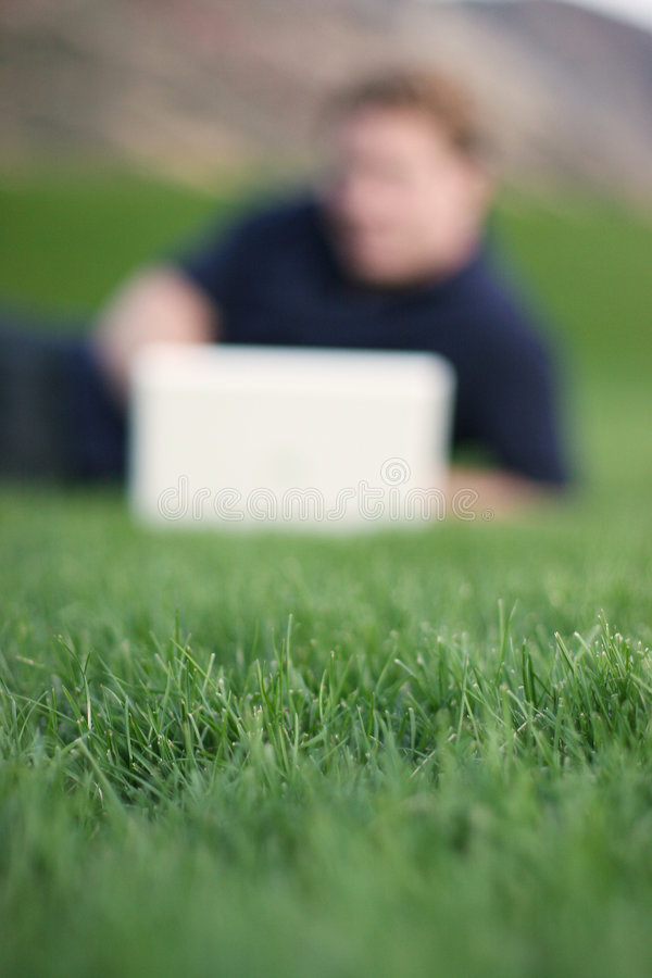 Green Grass, Blurred Computer User royalty free stock images