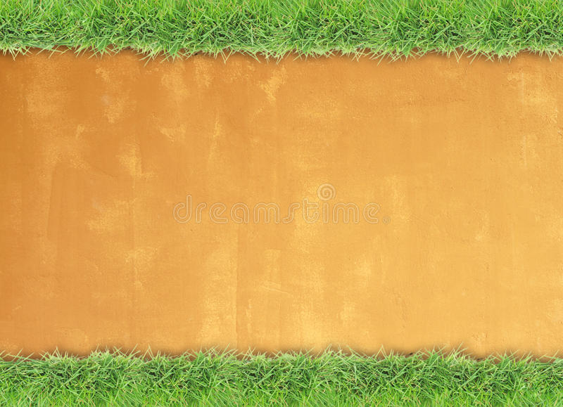 Green grass border on cement wall background. Green grass border on retro style cement wall background stock images