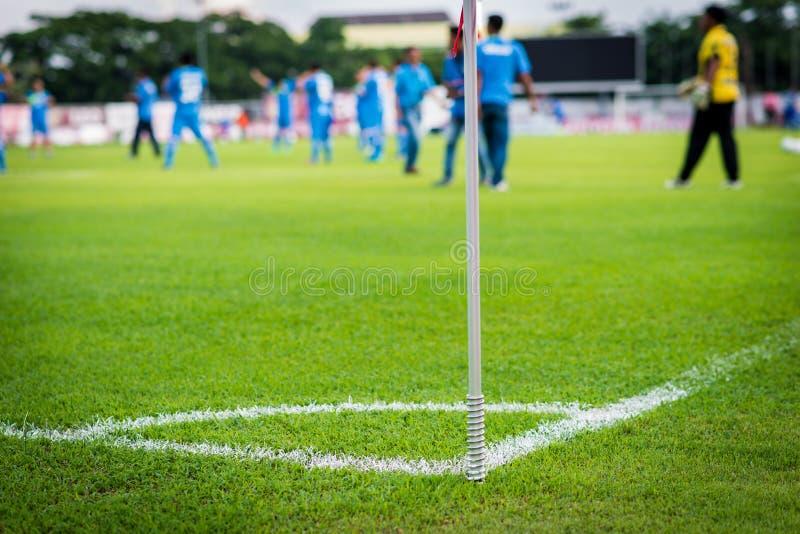 Green grass conner of football field stock photos