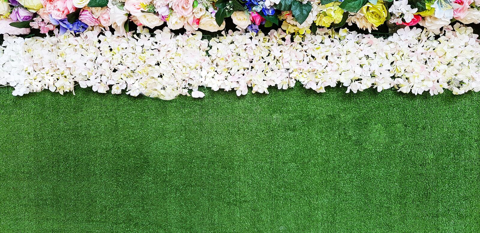 Green grass decorated with flowers for background and copy space. stock image