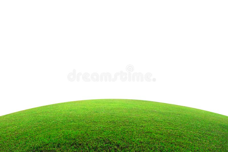 Green grass field on mountain isolated on white background. Beautiful grassland with slope.  Clipping path. Green grass field on mountain isolated on white royalty free stock images
