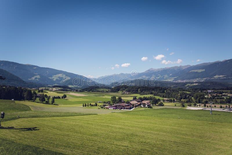 Green Grass Field Under Blue Sky stock photography