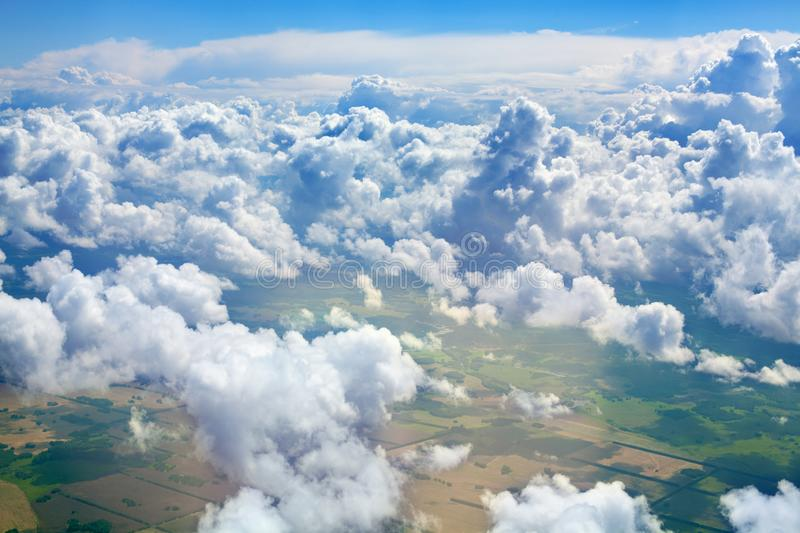 Green grass fields, forests, blue sky and white cumulus fluffy clouds background panoramic aerial view, sunny summer landscape. Green grass fields, forests, blue stock photo