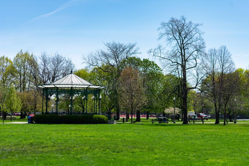 Green Grass and a Gazebo at Welles Park in Lincoln Square Chicago. An open field of green grass and a gazebo at Welles Park in the Lincoln Square neighborhood of royalty free stock image