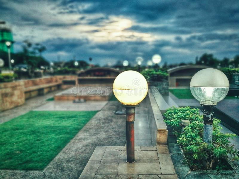 Green Grass With Gray Concrete Pavement Frame stock photos