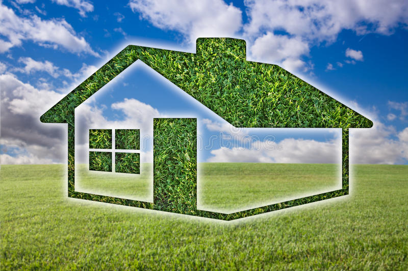 Green Grass House Icon Over Field, Sky and Clouds. Green Grass House Icon Over Field, Blue Sky and Clouds royalty free stock photo
