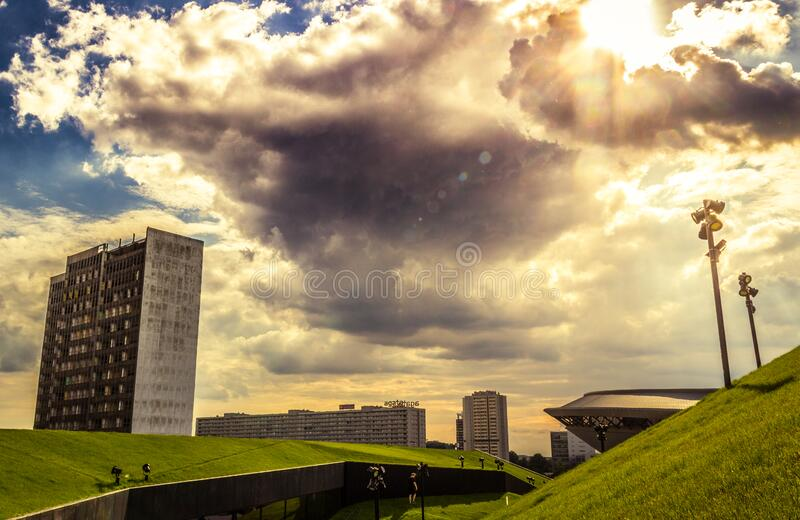 Green Grass Land Under Blue and White Cloudy Sky during Day Time royalty free stock photography