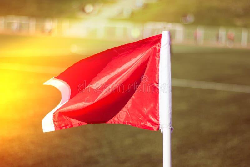 Green grass soccer field, corner flag close-up stock photo