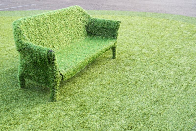 Green grass sofa. Empty green artificial grass sofa on artificial grass royalty free stock photos
