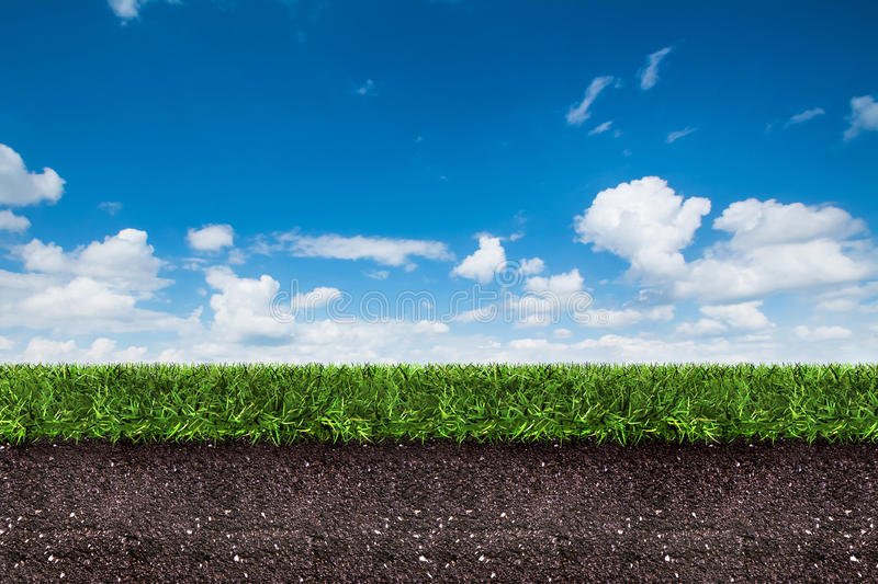Green grass with soil on blue sky. stock illustration