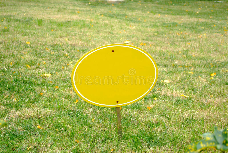 Green grass and Wooden sign royalty free stock photo