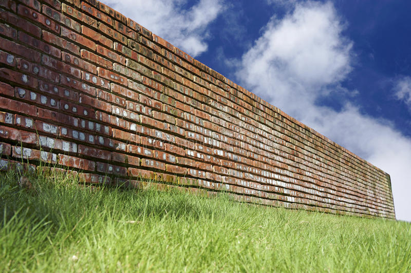 Download Green Grasses And Brick Wall Over Blue Sky Stock Image - Image: 26661633