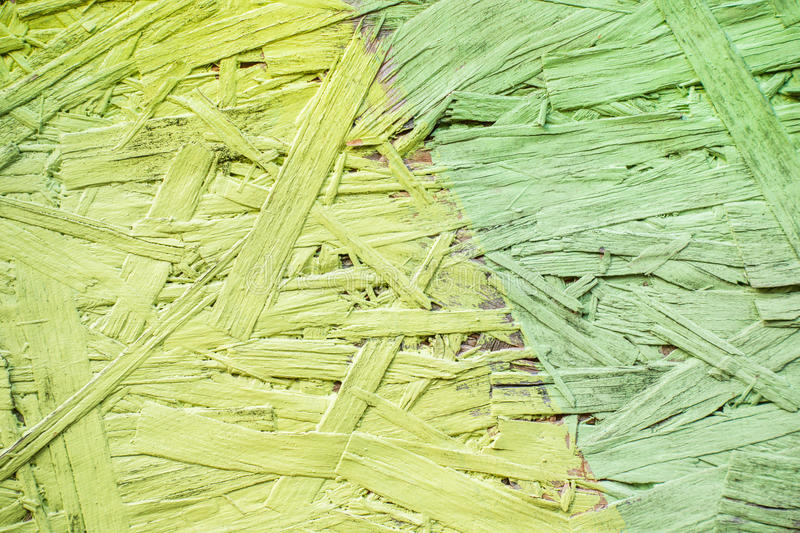 Green and greenery painted wood chipboard texture background. Close up royalty free stock image