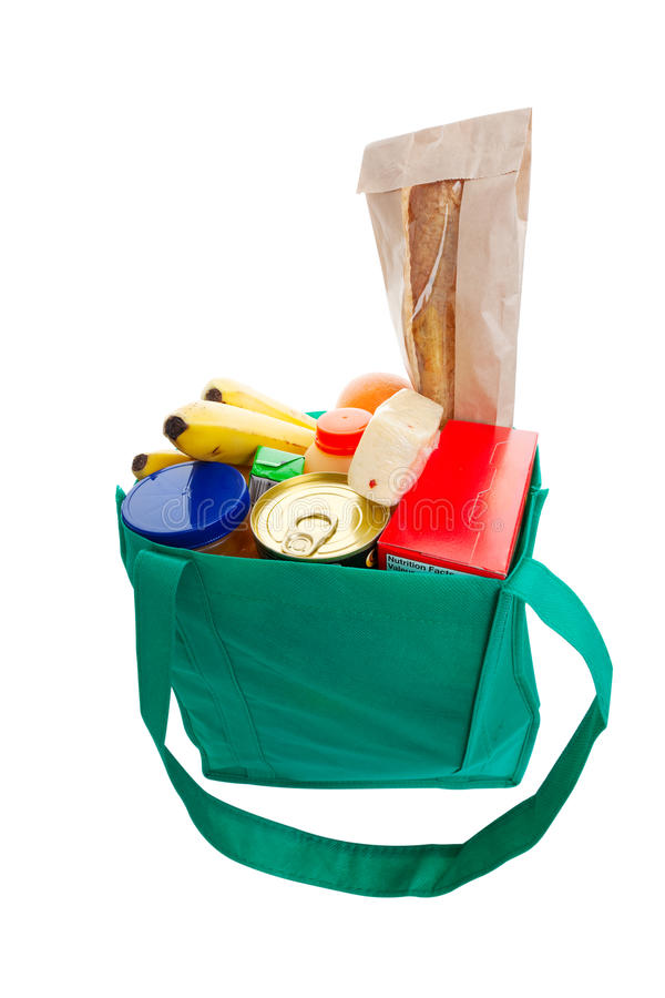 Green grocery bag. Eco friendly green cloth grocery bag full of food stock images