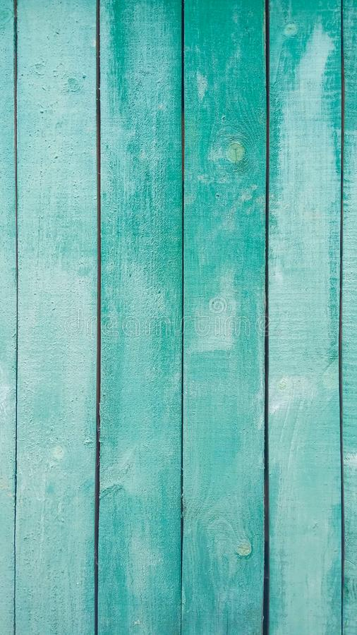 Green grunge  wooden wall. Natural green stripes pattern texture for background. Vertical emerald boards of a table, fence royalty free stock photography