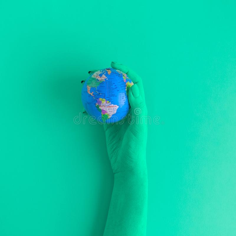Hand holding globe abstract concept. royalty free stock photography
