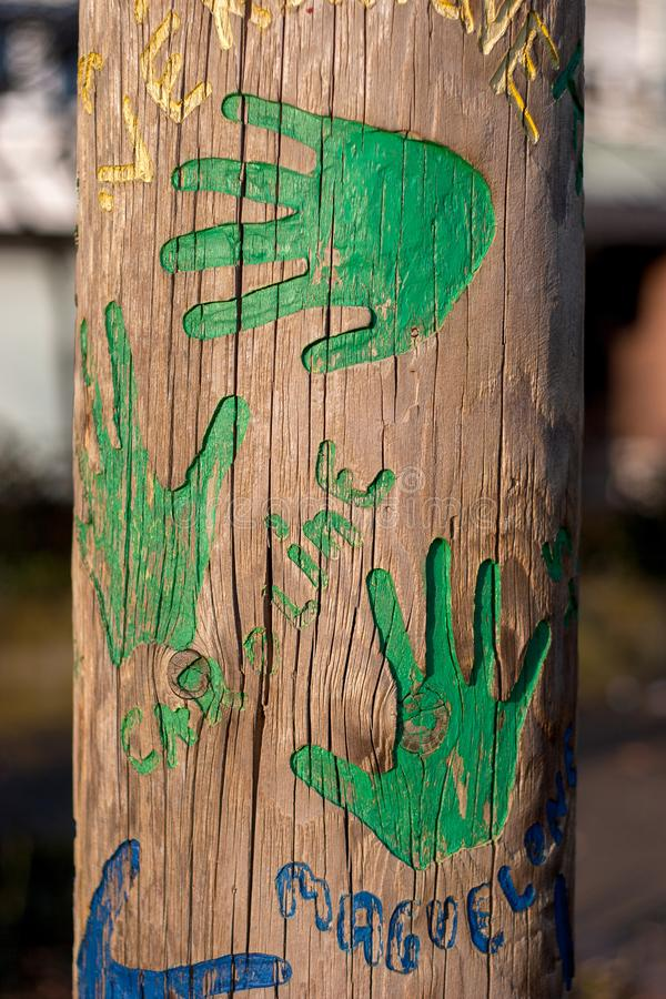 Green hands on a tree trunk stock images
