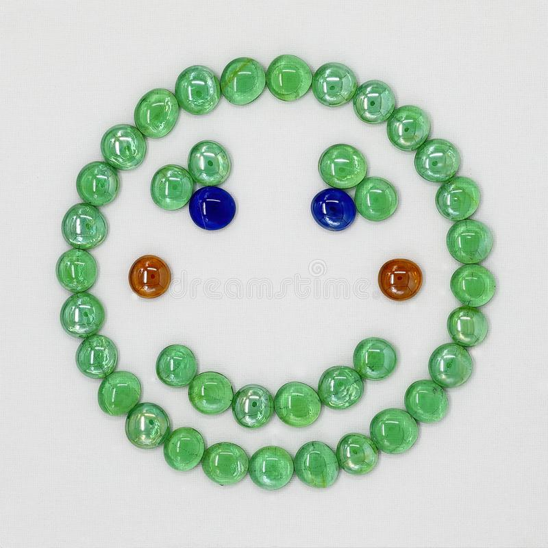 Green happy smilie from smalt in 3D stock photography