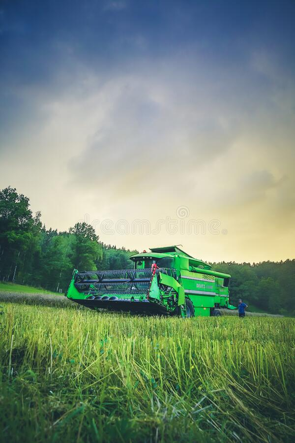 Green Harvester on Green Rice Field Under Blue and White Sky during Daytime stock images