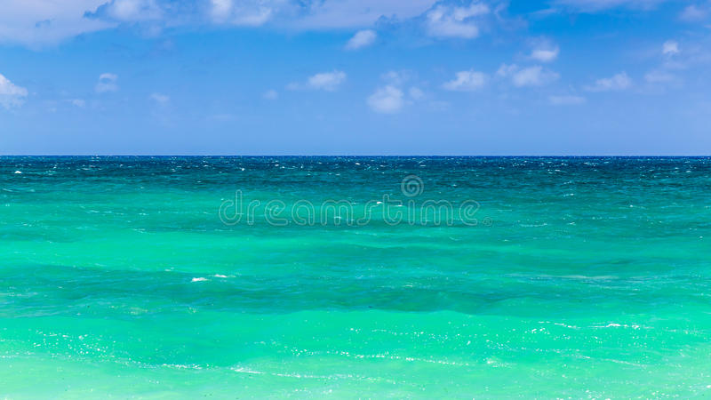 Green Hawaiian Sea. From deep blue to green and turquoise, these are the colours of the sea at Baldwin Beach on the North shore of Maui, Hawaii stock image