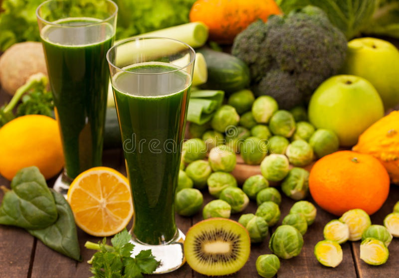 Green healthy detox smoothie. With fruits and vegetables royalty free stock image