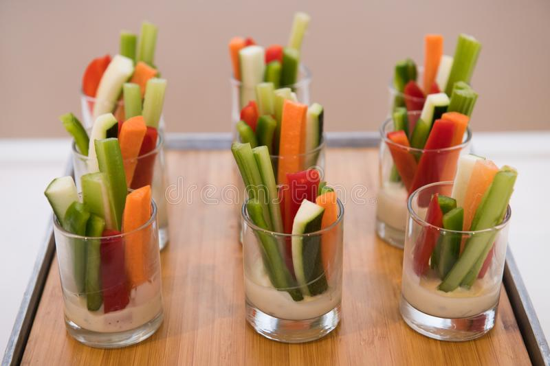 Green healthy gluten-free vegetarian salad mix appetizer snacks on catering event table stock photo