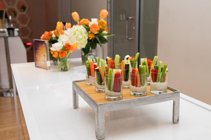 Green healthy gluten-free vegetarian salad mix appetizer snacks on catering event table stock photos