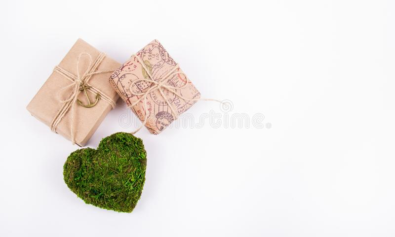 Green heart and gifts. Romantic concept. Natural Valentine card. St. Valentine`s Day. Copy space royalty free stock images