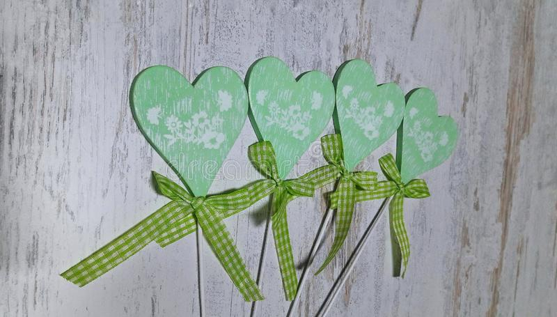 Green heart on a light background stock images