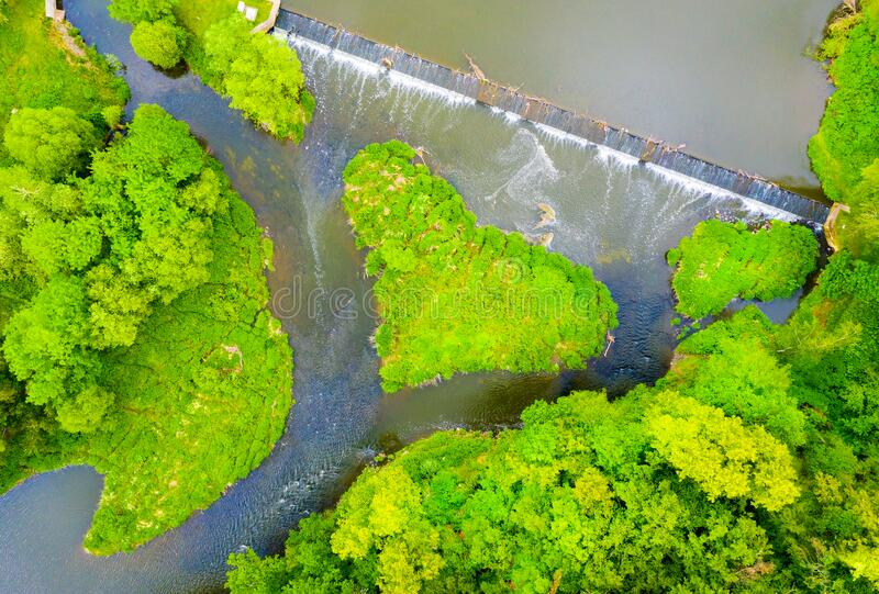 Green heart shaped island on river. royalty free stock images
