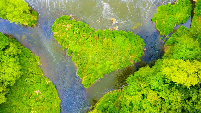 Green heart shaped island on river. royalty free stock image