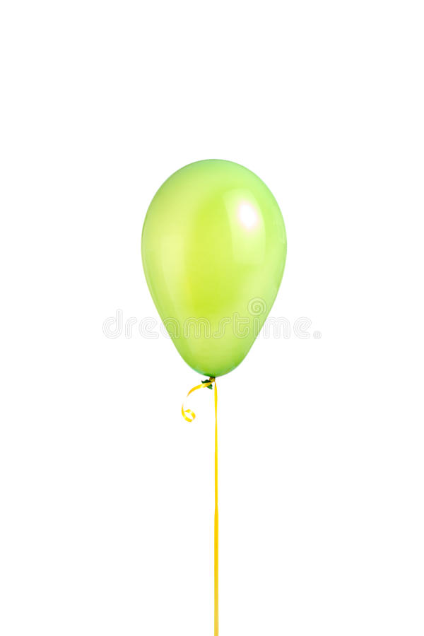 Green helium balloon. A single green helium-filled balloon on a ribbon royalty free stock image