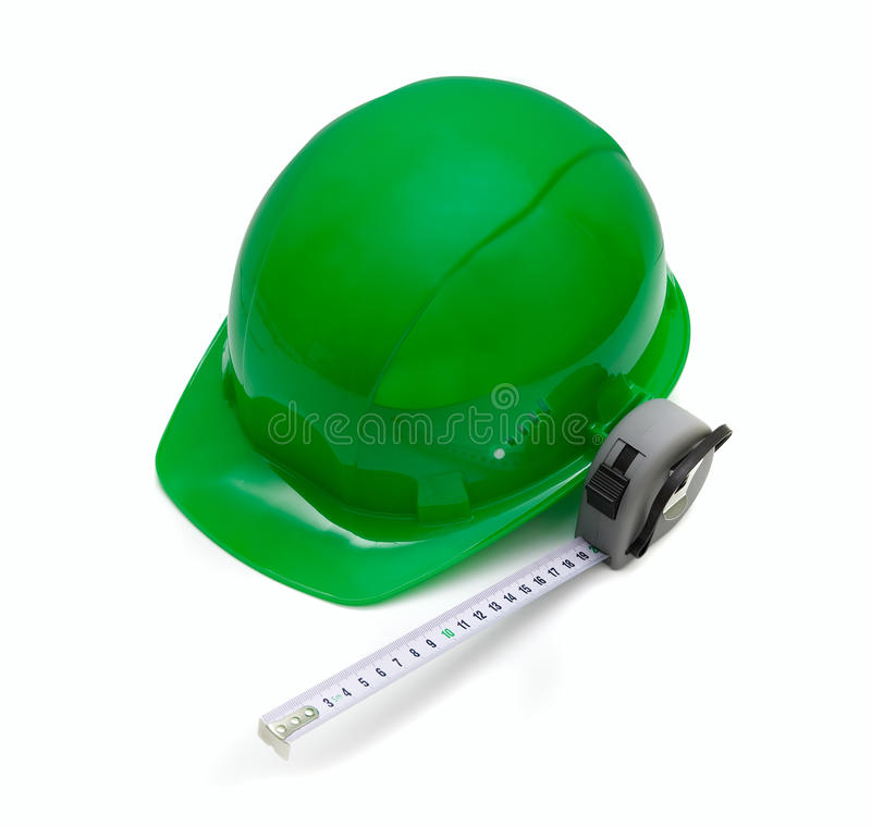 Green helmet and measuring tape stock photography