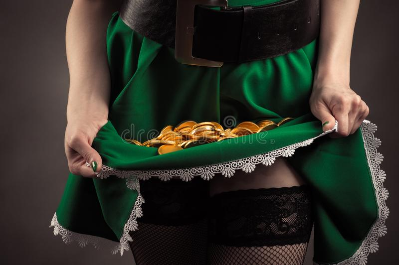 Green hem girl with coins inside closeup royalty free stock images