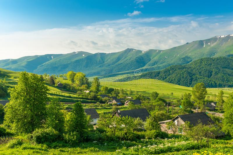 Green high mountain ranges on a sunny summer day in Armenia stock images