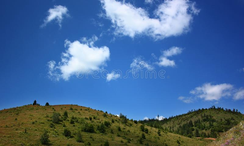 Green hills and blue sky royalty free stock photography
