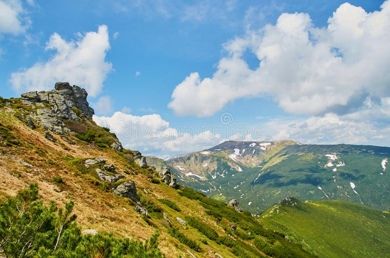 Green hills in Carpathian mountains in the spring. Mountains landscape background stock photography