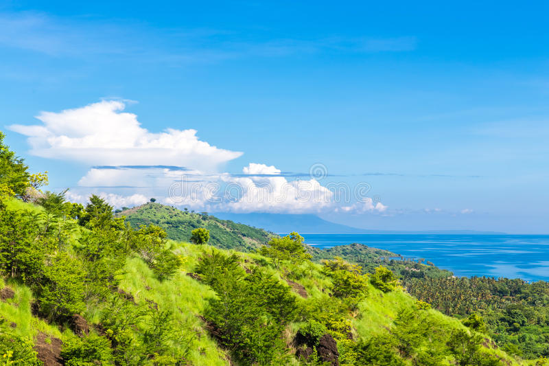 Green hills in the ocean royalty free stock images