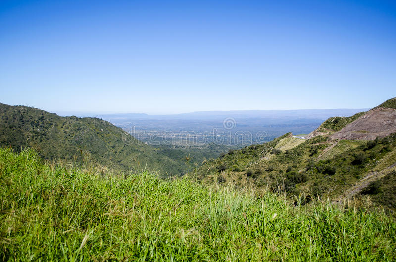 Green hills panoramic view stock photography