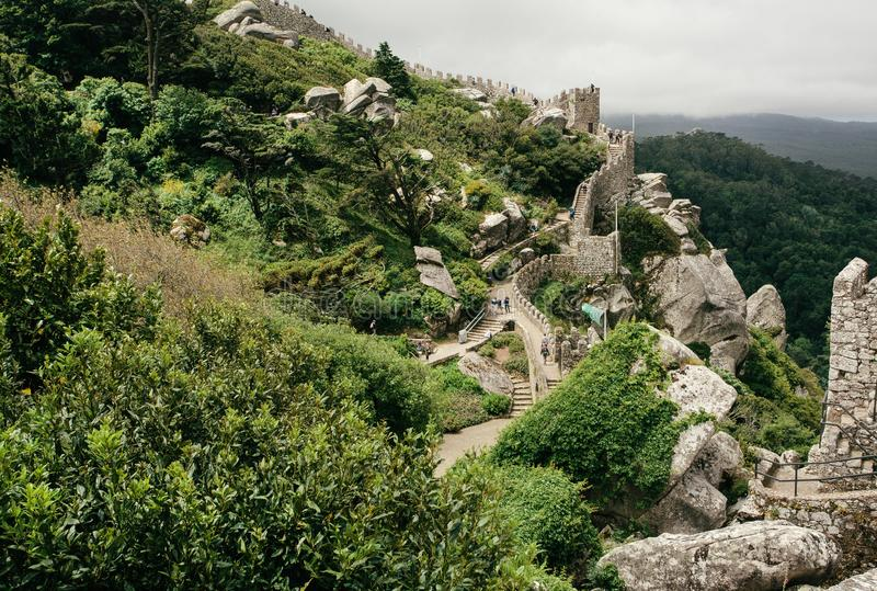 Green hills and stone towers of the 8th century The Moorish Castle over town Sintra. Historical landscape in Portugal stock photos