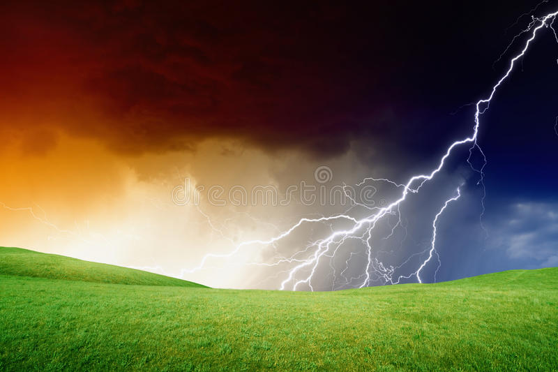 Green hills, stormy sky. Abstract nature background - green hills, dark stormy sky, lightning royalty free stock photo