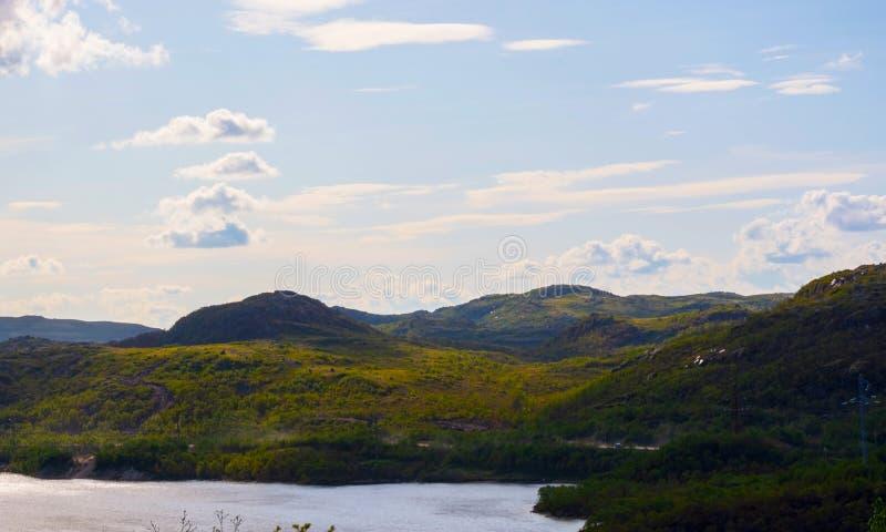 Green hills under a low, deep Northern sky stock photos