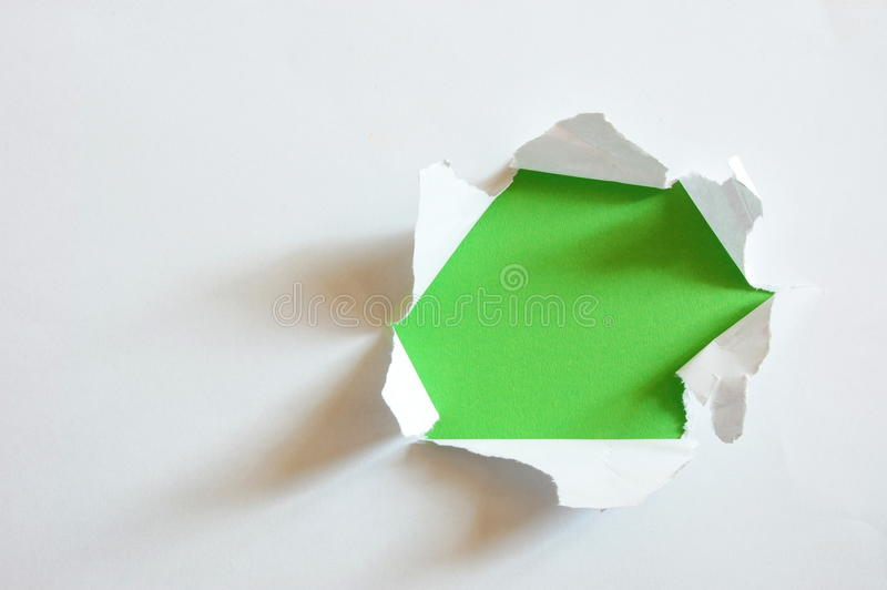 Green hole in blank sheet paper stock photo