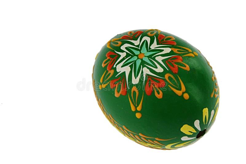 Green home made easter egg with flower ornamental painting, white background stock photos